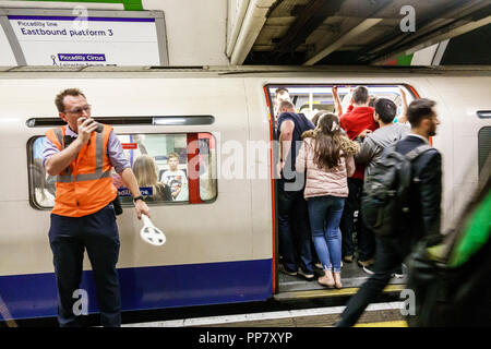 London England United Kingdom Great Britain Piccadilly Circus Underground Station subway tube public transportation mass transit inside platform condu - Stock Photo