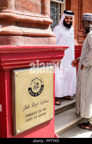 London England United Kingdom Great Britain West End City Westminster Mayfair Embassy of the State of Qatar exterior Asian Black man thawb thobe white - Stock Photo