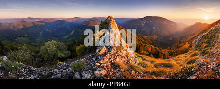Rocky Panorama of sunset in mountain valley landscape. - Stock Photo
