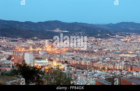 Spain, Cityscape of Barcelona at night. - Stock Photo