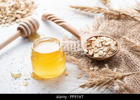 Wheat, honey and rolled oats. Concept of healthy eating, healthy lifestyle, dieting, weight loss food - Stock Photo