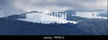 Winter landscape. Panorama overlooking the mountain village. Carpathians, Ukraine, Europe - Stock Photo