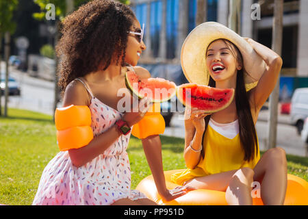 Happy positive women laughing from the jokes - Stock Photo