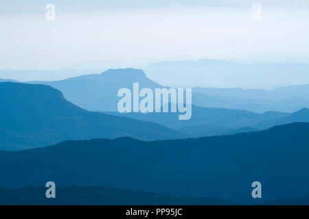 Blue layers of mountain ridges in the french alps. - Stock Photo