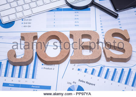 Text 'JOBS' on the office desk for the unemployed jobs search - Stock Photo