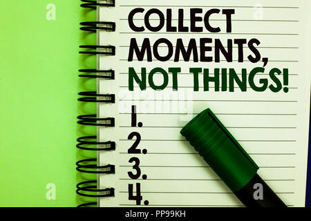 Handwriting text Collect Moments, Not Things. Concept meaning Happiness philosophy enjoy simple life facts Written letters and numbers on notepad laid - Stock Photo