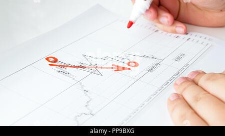 Closeup image of businessman analyzing financial graph - Stock Photo