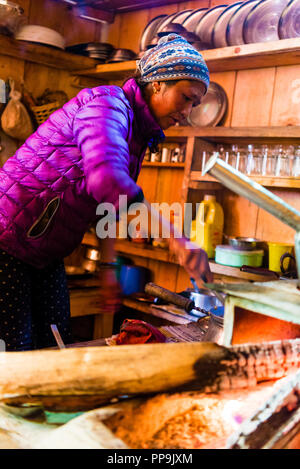 Annapurna Conservation Area, Nepal - July 19, 2018 : Food preparation at local restaurant lodge on the Annapurna trekking circuit - Stock Photo