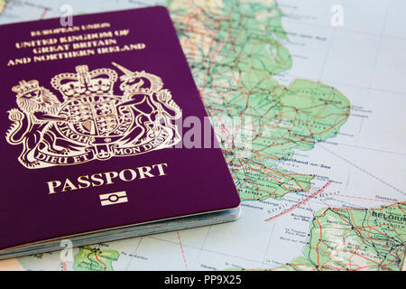 European Union United Kingdom British Passport on a map of England and France showing English Channel routes from Dover to Calais. Brexit concept. UK - Stock Photo
