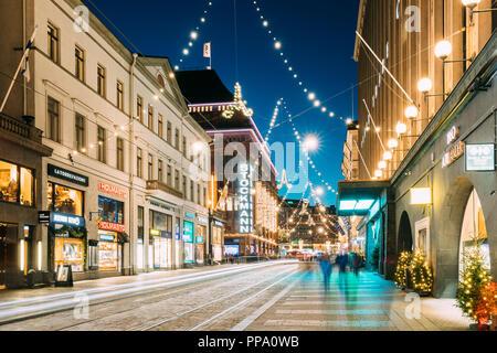 Helsinki, Finland - December 6, 2016: Night View Of Aleksanterinkatu Street With Railroad In Kluuvi District In Evening Christmas Xmas New Year Festiv - Stock Photo