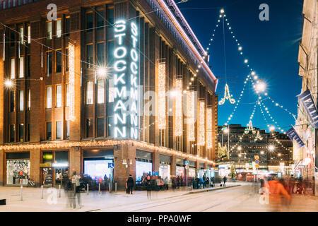 Helsinki, Finland - December 6, 2016: Building Of Stockmann Department Store On Aleksanterinkatu Street In Evening Or Night Christmas Xmas New Year Fe - Stock Photo