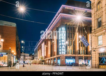 Helsinki, Finland - December 6, 2016: Building Of Stockmann Department Store On Keskuskatu Street In Evening Or Night Christmas Xmas New Year Festive  - Stock Photo