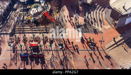 People are on move in Cape tow, South Africa, street musicians playing music. Areal view from Victoria & Alfred Waterfront. - Stock Photo