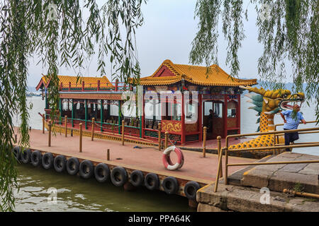 Dragon boat on the Kunming Lake, Beijing, China at Beihai Park pavilion. Former imperial garden (near Forbidden City) built in 11th century, one of th - Stock Photo