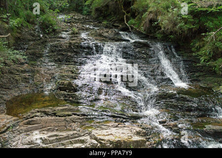 Plodda Falls is a waterfall 5 km southwest of the village of Tomich, near Glen Affric, in the Highlands of Scotland. - Stock Photo