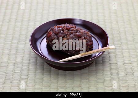 ohagi ( botamochi ), rice cake covered with sweet red bean paste, traditional japanese sacred food - Stock Photo