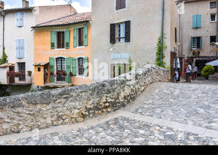 village Moustiers-Sainte-Marie, Provence, France, houses at stone bridge, member of most beautiful villages of France - Stock Photo