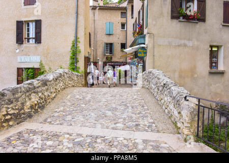 stone bridge of the village Moustiers-Sainte-Marie, Provence, France, houses at stone bridge, member of most beautiful villages of France - Stock Photo
