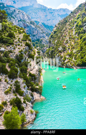 entrance to the Verdon Gorge with cliffy rocks at lake of Sainte-Croix, Provence, France, near Moustiers-Sainte-Marie - Stock Photo