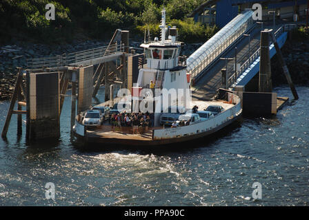 Small ferry which transports passengers and cars across the small stretch of water which separates the town of Ketchikan, Alaska, from its airport. - Stock Photo
