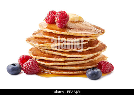 Stack of pancakes with maple syrup and fresh berries on white - Stock Photo