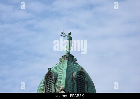 Statue of Lady Justice on top of Rockingham County Courthouse in Harrisonburg, Virginia - Stock Photo