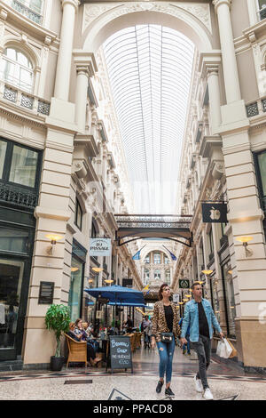 The Hague, Netherlands - August 24, 2018: The Passage shopping arcade interior in The Hague, Netherlands. Indoor picture with architectural roof detai - Stock Photo