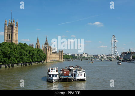 view from lambeth bridge over the river thames, london, england, towards the houses of parliament, westminster bridge and the london eye - Stock Photo