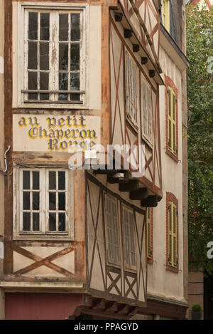 Painted restaurant sign on decorative half-timbered building Morlaix Brittany France - Stock Photo