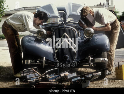 Two enthusiasts working on a 1950's Citroen Traction Avant in France 1984 - Stock Photo
