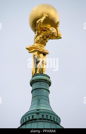 Golden statue of Atlas - Stock Photo