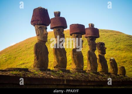 Moais of Ahu Nau Nau in Anakena beach in Easter Island, Chile - Stock Photo
