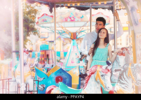 Young couple on a date at the fair - Stock Photo