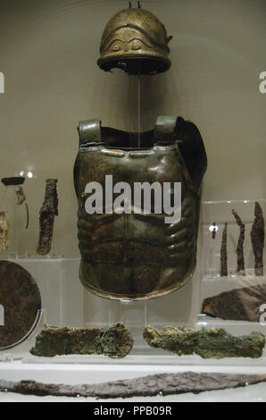 Italy. Lavinium. Tomb of the Warrior. Armor and weapons. First quarter of the 5th century BC. National Roman Museum (Baths of Diocletian). Rome, Italy. - Stock Photo