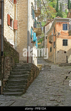 Old Cobblestone Streets and Stairs of Kotor in Montenegro - Stock Photo