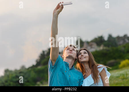 Sweet couple takes selfies - Stock Photo