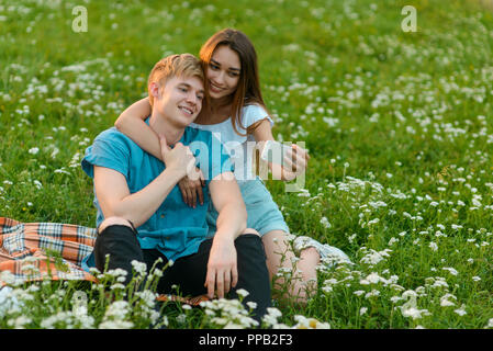 Lovely couple takes selfies - Stock Photo