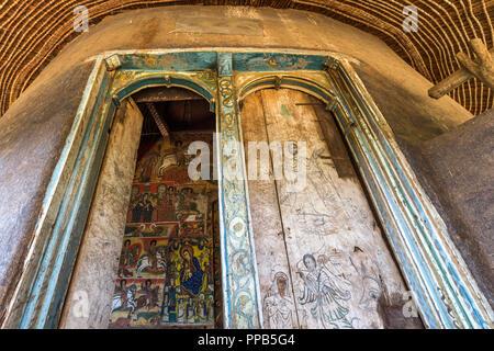 Original wooden doors, Frescos, Ura-Kidane Miheret monastery, Zenge Peninsula, Lake Tana, Ethiopia - Stock Photo