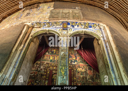 Original wooden doors, Frescos, Ura-Kidane Miheret monastery, Zenge Peninsula, Lake Tana, Ethiopia - Stock Photo