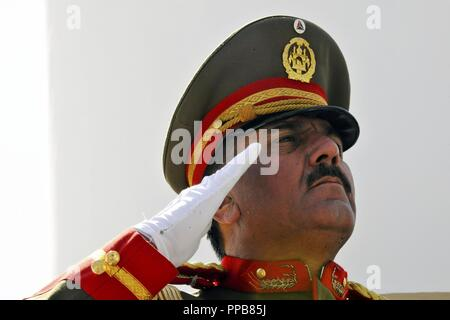 KABUL, Afghanistan (August 19, 2018) An Afghan armed forces Honor Guard member salutes during the playing of the Afghan national anthem at an Afghan Independence Day celebration in Kabul, Afghanistan, Aug. 19, 2018. - Stock Photo