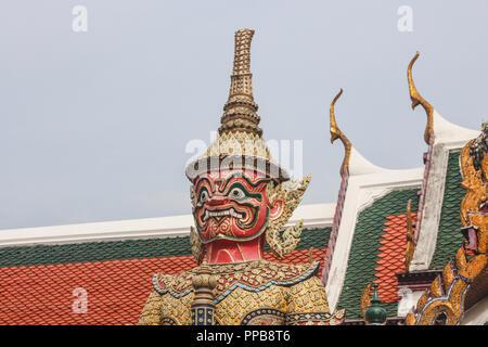 Intricately detailed giant demon guardian statue in Wat Phra Kaew temple. Bangkok, Thailand. - Stock Photo