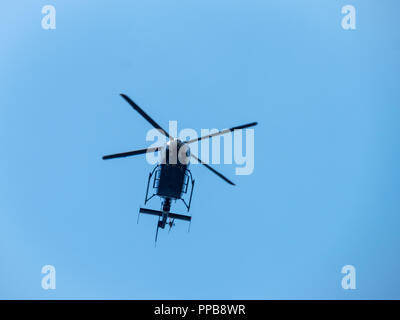 Flying helicopters in the blue open sky. - Stock Photo