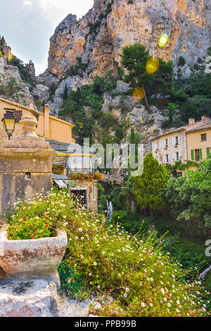 village Moustiers-Sainte-Marie, Provence, waterfall and surrounding cliffy mountains, France, member of most beautiful villages of France - Stock Photo