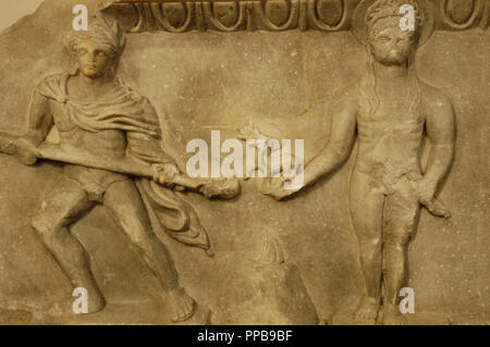 Relief depicting a cult statue of Apollo, standing between two torch-bearers. The image of god are a quotation from a famous archaic cult statue by Kanachos. 175-200 AD. Marble. From the theater of Miletus. Detail. Pergamon Museum. Berlin. Germany. - Stock Photo