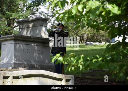 Staff Sgt. David Lambermont, 88th Readiness Division's 338th Army Band bugler, performs Taps during at a wreath laying ceremony for President Benjamin Harrison at Crown Hill Cemetery, in Indianapolis, on Aug. 18, to commemorate the Hoosier President's 185th birthday. (US Army - Stock Photo
