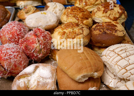 Traditional Mexican sweet buns and other baked goods for sale in in the Mercado Pino Suarez Market,  Mazatlan, Sinaloa, Mexico - Stock Photo