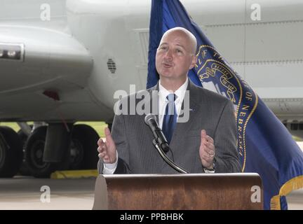 Nebraska Gov. Pete Ricketts provides remarks August 28, 2018 inside an aircraft hangar at Offutt AFB, Nebraska during an event celebrating a more than $1 million investment by the U.S. Department of Defense to STEM education in the Bellevue Public Schools system, which is the nearest community to Offutt AFB. The award is part of the National Math and Science Initiative that promotes STEM education in more than 200 U.S. schools that have significant enrollment among military-connected students. - Stock Photo