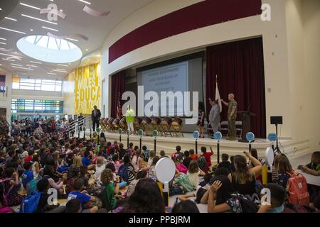 CAMP FOSTER, OKINAWA, Japan - Reynaldo Toquero speaks with faculty and families at the opening of Zukeran Elementary School's new facility on Camp Foster, Okinawa, Japan, Aug. 29, 2018. The new facility was constructed to support the education and welfare of the U.S. community on Camp Foster. Toquero is the principal of Zukeran Elementary School. - Stock Photo