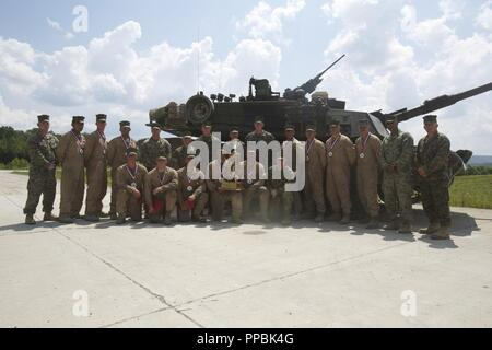 Lt. Gen. Brian D. Beaudreault, the deputy commandant of plans, policies, and operations, poses for a photo with the crews from 1st, 2nd, and 4th Tank Battalion after the awards ceremony at the 15th annual Tiger Competition awards ceremony at Wilcox Range, Fort Knox, Ky., Aug. 28, 2018.