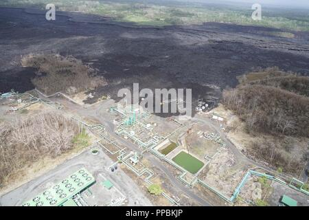 Aerial view of Puna Geothermal Ventures which was encroached upon by lava from the recent three month eruption in Leilani Estates on Hawaii Island. The Hawaii Army National Guard provided key leadership from the Hawaii County, FEMA, USGS, and the Hawaii National Guard with an aerial survey of areas of the island effected by the recent eruption and hurricane Lane. August 29 2018, Hilo Hawaii. - Stock Photo